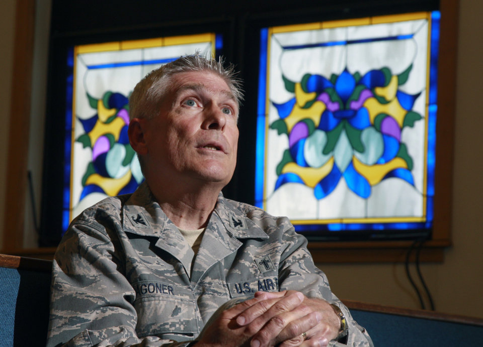 Photo -   ADVANCE FOR USE THURSDAY, JULY 5, 2012 AND THEREAFTER - In this Wednesday, June 27, 2012 photo, U.S. Air Force chaplain Col. Timothy Wagoner reflects on a question as he sits in the McGuire Air Force Base chapel at Joint Base McGuire-Dix-Lakehurst in Wrightstown, N.J. Wagoner, who commands five fellow chaplains at the base in central New Jersey, has been an Air Force chaplain for 20 years, serving a denomination - the Southern Baptists - that officially frowns on same-sex relationships. He said the chaplaincy corps was responding professionally and creatively to what he called a
