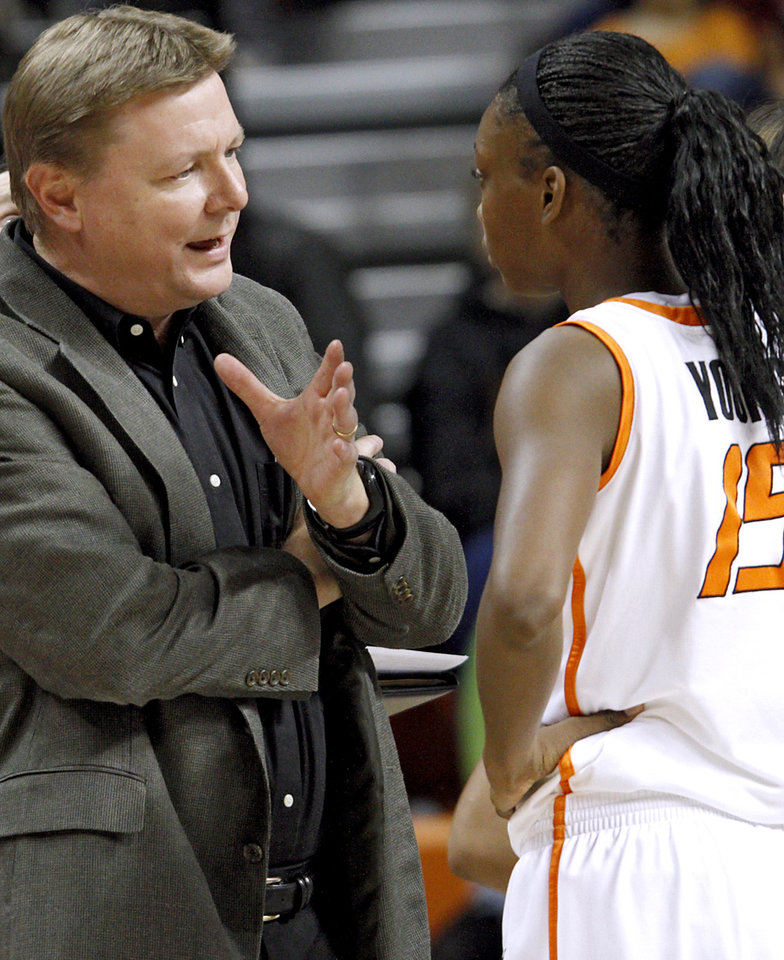 Photo - Oklahoma State's Head Coach Kurt Budke talks with Toni Young during a timeout in their college basketball game against Arkansas-Pine Bluff's at Gallagher-Iba Arena on the OSU campus in Stillwater, Oklahoma on Monday, Dec. 27, 2010. Photo by John Clanton, The Oklahoman