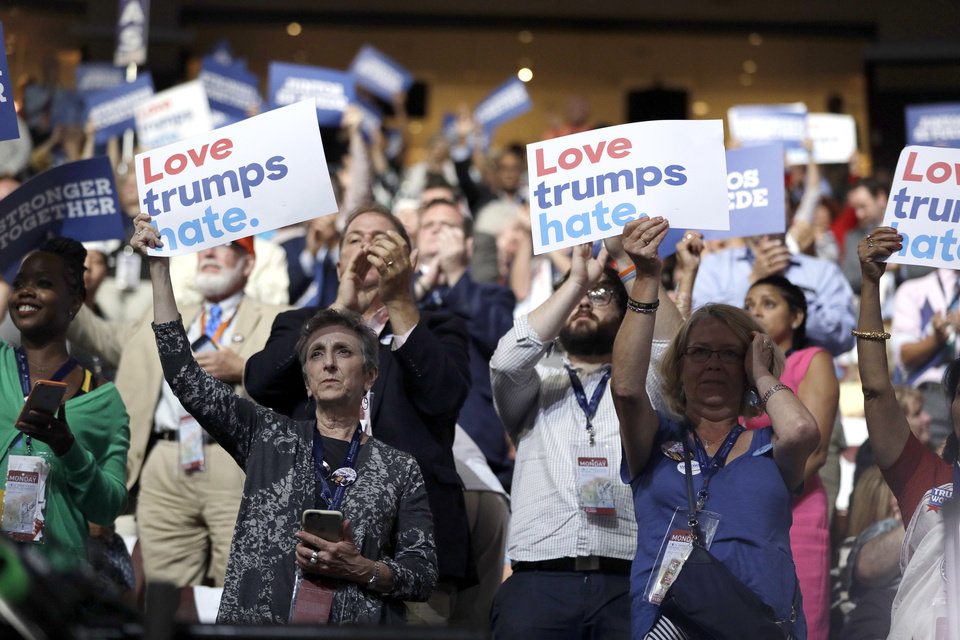 Photo - Massachusetts delegates cheer during the first day of the Democratic National Convention in Philadelphia , Monday, July 25, 2016. (AP Photo/John Locher)