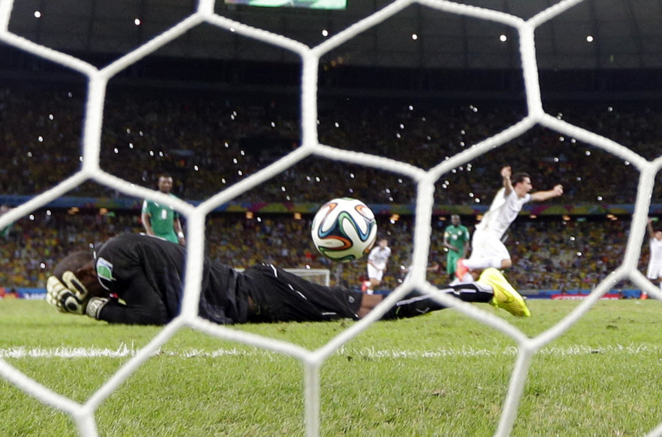 Photo - Greece's Giorgos Samaras, right, celebrates scoring his side's second goal from the penalty spot during the group C World Cup soccer match between Greece and Ivory Coast at the Arena Castelao in Fortaleza, Brazil, Tuesday, June 24, 2014. (AP Photo/Fernando Llano)