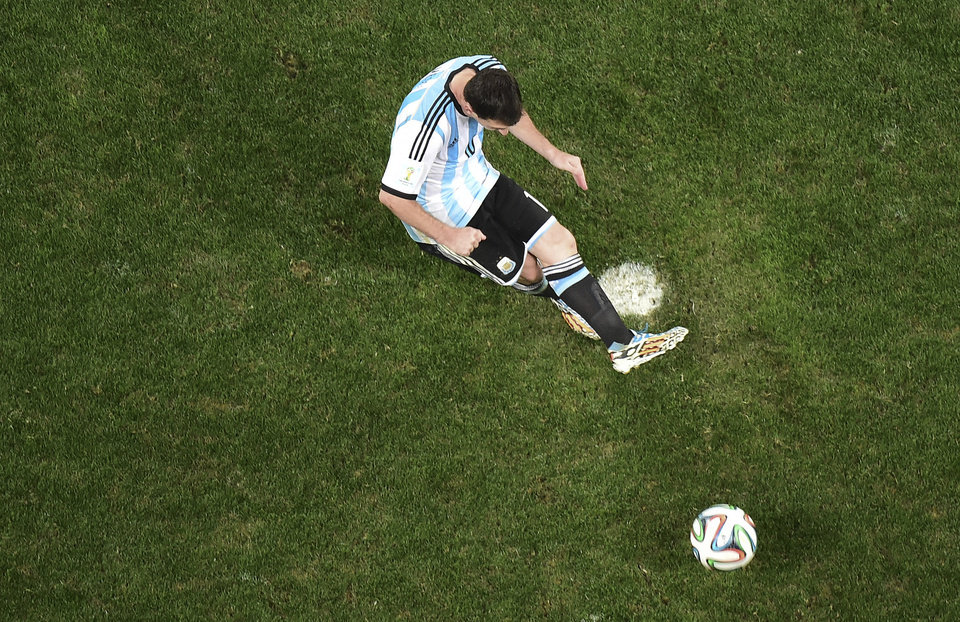 Photo - Argentina's Lionel Messi scores on a penalty kick during the World Cup semifinal soccer match between the Netherlands and Argentina at the Itaquerao Stadium in Sao Paulo, Brazil, Wednesday, July 9, 2014. Argentina beat the Netherlands 4-2 in a penalty shootout to reach the World Cup final against Germany. (AP Photo/Francois Xavier Marit, Pool)