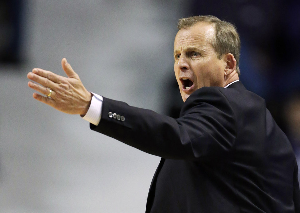 Texas head coach Rick Barnes yells to his team during the first half of an NCAA college basketball game against the Kansas State  in Manhattan, Kan., Wednesday, Jan. 30, 2013. (AP Photo/Orlin Wagner)