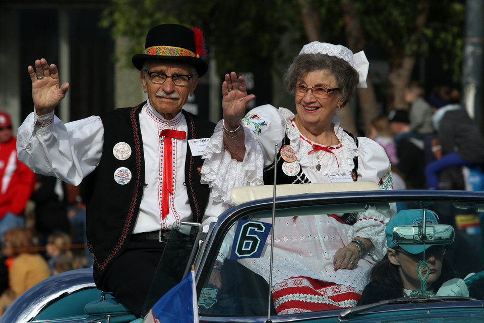 Yukon Czech Festival Grand marshals Paul and Laverne Stejskal wave to the crowd during the Czech Festival parade Saturday in Yukon. Photo by Hugh Scott, for the Oklahoman