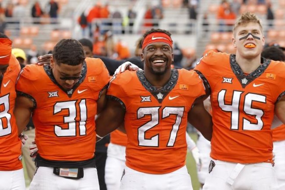 Photo -  Oklahoma State running back Dezmon Jackson (27) smiles beside safety Kolby Harvell-Peel (31) and linebacker Jeff Roberson (45) after beating Texas Tech on Saturday in Stillwater. [Bryan Terry/The Oklahoman]