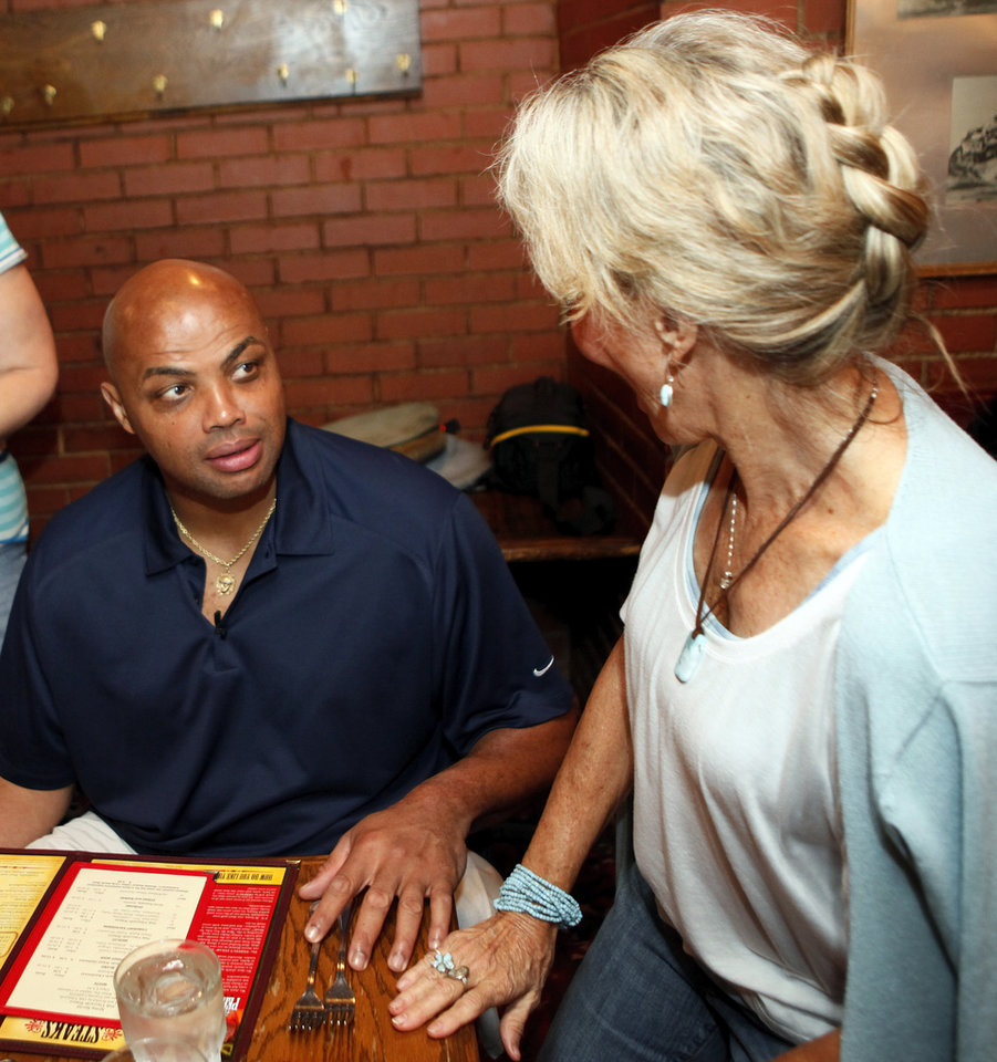 Photo - Charles Barkley talks with Ann Hussong while at Cattlemen's Steakhouse in Oklahoma City, Friday, June 1, 2012. Photo by Nate Billings, The Oklahoman