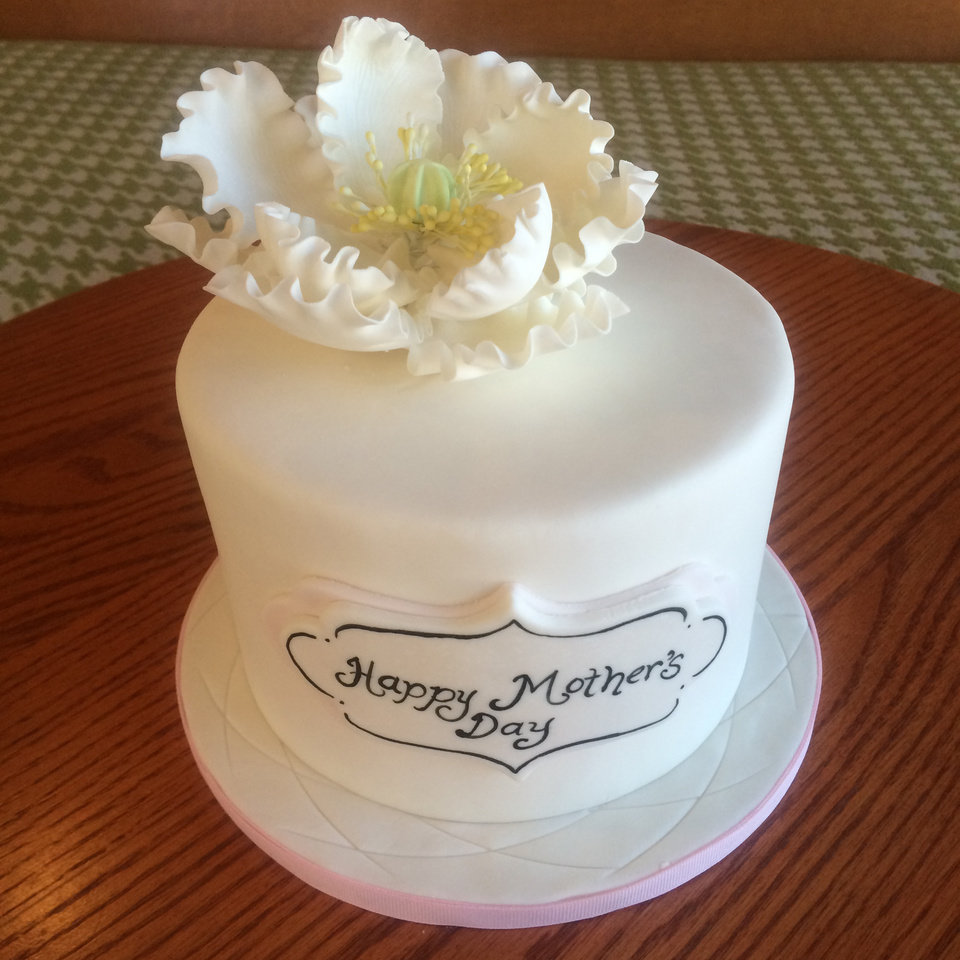 Photo - This undated photo provided by Tiffany Jones and posted in May 2014 to the Instagram account of her company, Peridot Sweets Las Vegas, shows a Mother's Day cake. Jones says she sold seven of the cakes to people who saw the photo on Instagram. The photo also automatically posted to the company's Facebook page, which is followed by nearly 1,200. She sold six more cakes to Facebook fans. (AP Photo/Courtesy Tiffany Jones)