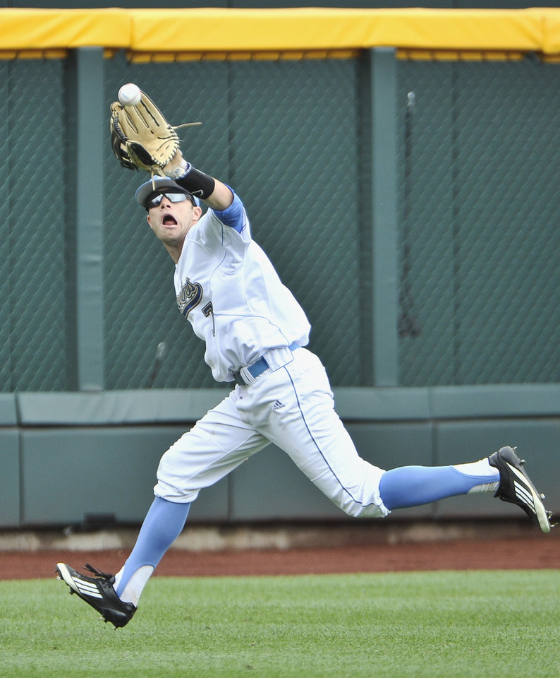 Photo -   UCLA outfielder Cody Keefer catches a flyball hit by Stony Brook's Pat Cantwell in the third inning of an NCAA College World Series baseball game in Omaha, Neb., Friday, June 15, 2012. (AP Photo/Eric Francis)
