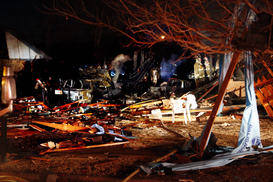 Photo - Firemen walk through the remains of a house destroyed by a natural gas explosion near SW 92nd and Fairview on Thursday, Jan. 3, 2013  in Oklahoma City, Okla. Photo by Steve Sisney, The Oklahoman