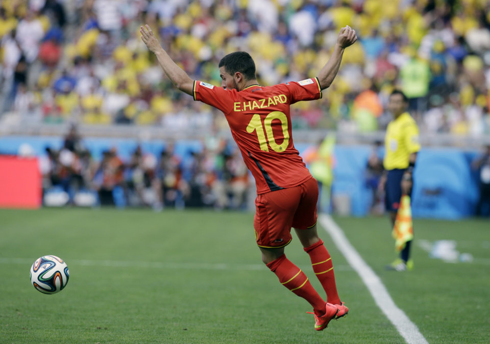 Photo - Belgium's Eden Hazard attempts to control the ball during the group H World Cup soccer match between Belgium and Algeria at the Mineirao Stadium in Belo Horizonte, Brazil, Tuesday, June 17, 2014. (AP Photo/Hassan Ammar)