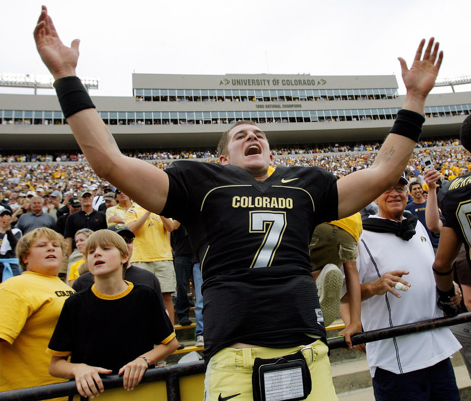 Photo - Colorado quarterback Cody Hawkins (7) celebrates after the college football game between the University of Oklahoma Sooners (OU) and the University of Colorado Buffaloes (CU) at Folsom Field in Boulder, Co., on Saturday, Sept. 28, 2007. Colorado won, 27-24. By NATE BILLINGS, The Oklahoman