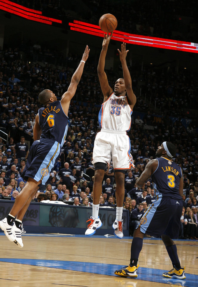 Photo - Oklahoma City's Kevin Durant (35) shoots in between Denver's Arron Afflalo (6) and Ty Lawson (3)during the NBA basketball game between the Denver Nuggets and the Oklahoma City Thunder in the first round of the NBA playoffs at the Oklahoma City Arena, Wednesday, April 27, 2011. Photo by Sarah Phipps, The Oklahoman