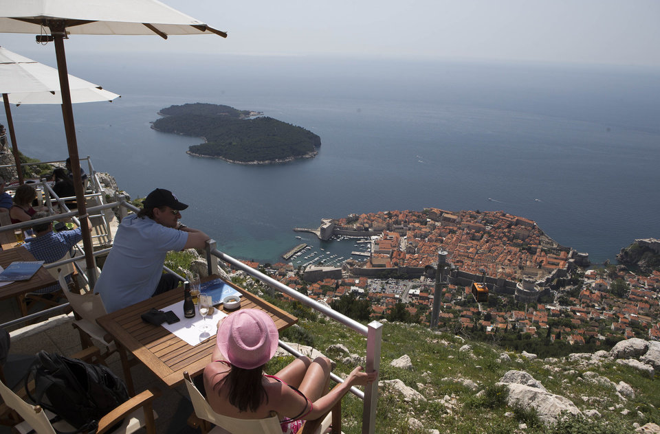 Photo - WITH STORY CROATIA GOLF REFERENDUM - Dubrovnik old town is pictured from Srdj, the hill above the city, Friday, April 26, 2013. The residents of this scenic Croatian Adriatic sea resort will hold a referendum on Sunday April 28, 2013, whether to allow the 1.1-billion euros ($1.4 billion) golf park development project on the hill above the city that many claim endangers their ancient city, often dubbed the Pearl of the Adriatic, and the outcome could have serious consequences on the future of foreign investments in Croatia.  (AP Photo/Darko Bandic)