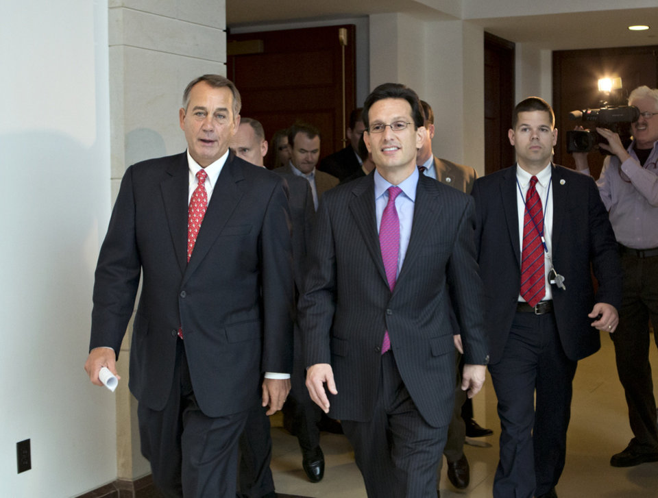 Photo - Speaker of the House John Boehner, R-Ohio, left, joined by House Majority Leader Eric Cantor, R-Va., returns to his office after speaking to reporters on the fiscal cliff negotiations, at the Capitol in Washington, Friday, Dec. 21, 2012. Hopes for avoiding the