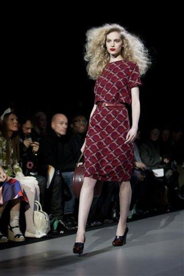 Photo - A model walks the runway during the Marc by Marc Jacobs Fall 2013 fashion show during Fashion Week, Monday, Feb. 11, 2013, in New York. (AP Photo/Karly Domb Sadof)