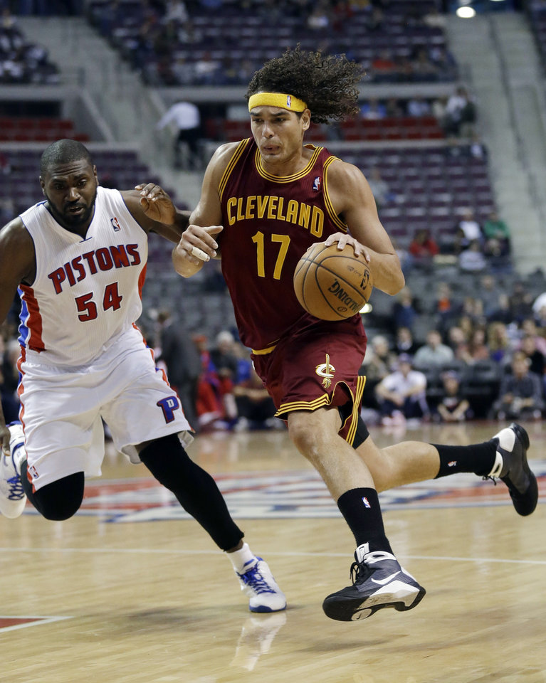 Cleveland Cavaliers center Anderson Varejao (17), of Brazil, drives on Detroit Pistons forward Jason Maxiell (54) during the first half of an NBA basketball game in Auburn Hills, Mich., Monday, Dec. 3, 2012. (AP Photo/Paul Sancya)