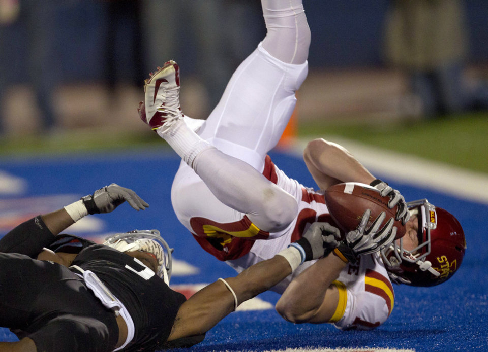 Iowa State wide receiver Josh Lenz (19) scores a touchdown over the top of Kansas cornerback Greg Brown (5) during the second half of an NCAA college football game in Lawrence, Kan., Saturday, Nov. 17, 2012. (AP Photo/Orlin Wagner)