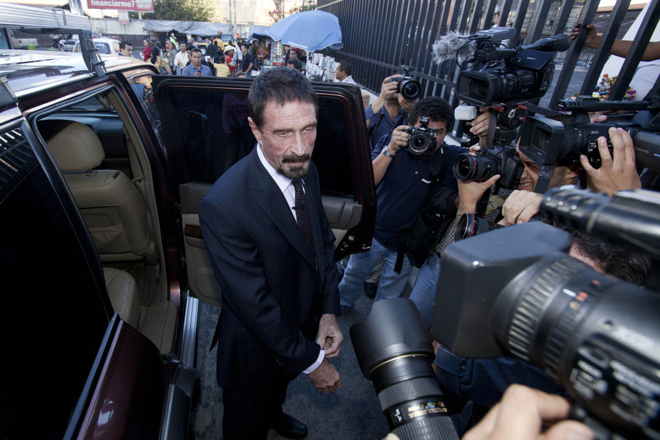 Photo - Software company founder John McAfee poses for pictures after a press conference outside the Supreme Court in Guatemala City, Tuesday, Dec. 4, 2012. McAfee, 67, who has been identified as a