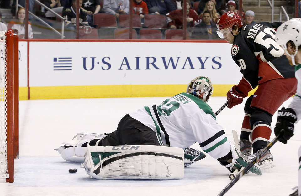 Photo - Phoenix Coyotes' Antoine Vermette (50) scores a goal against Dallas Stars' Kari Lehtonen, of Finland, during the second period of an NHL hockey game, Tuesday, Feb. 4, 2014, in Glendale, Ariz. (AP Photo/Ross D. Franklin)