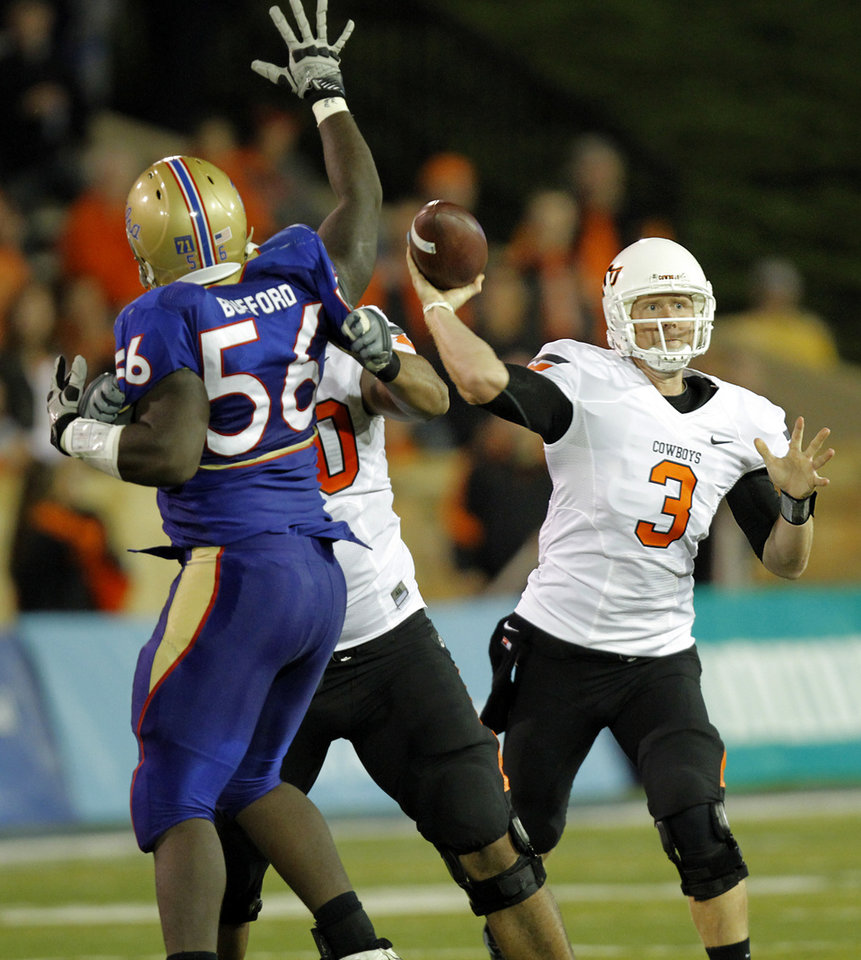 Oklahoma State's Brandon Weeden (3) throws the ball against Tulsa during a college football game between the Oklahoma State University Cowboys and the University of Tulsa Golden Hurricane at H.A. Chapman Stadium in Tulsa, Okla., Sunday, Sept. 18, 2011. Photo by Chris Landsberger, The Oklahoman