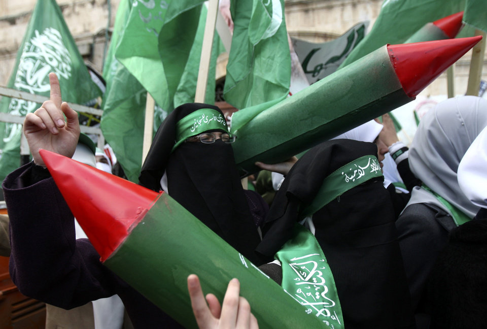 Photo - Palestinian supporters of Hamas hold models of M75 long-range rockets during a rally to celebrate the 25th anniversary of the Hamas militant group, in the West Bank city of Nablus, Thursday, Dec. 13, 2012. Hamas supporters rallied in the first display of force by the Islamic militant group in the West Bank since it overran Gaza from the Western-backed party of Palestinian President Mahmoud Abbas in 2007. (AP Photo/Nasser Ishtayeh)