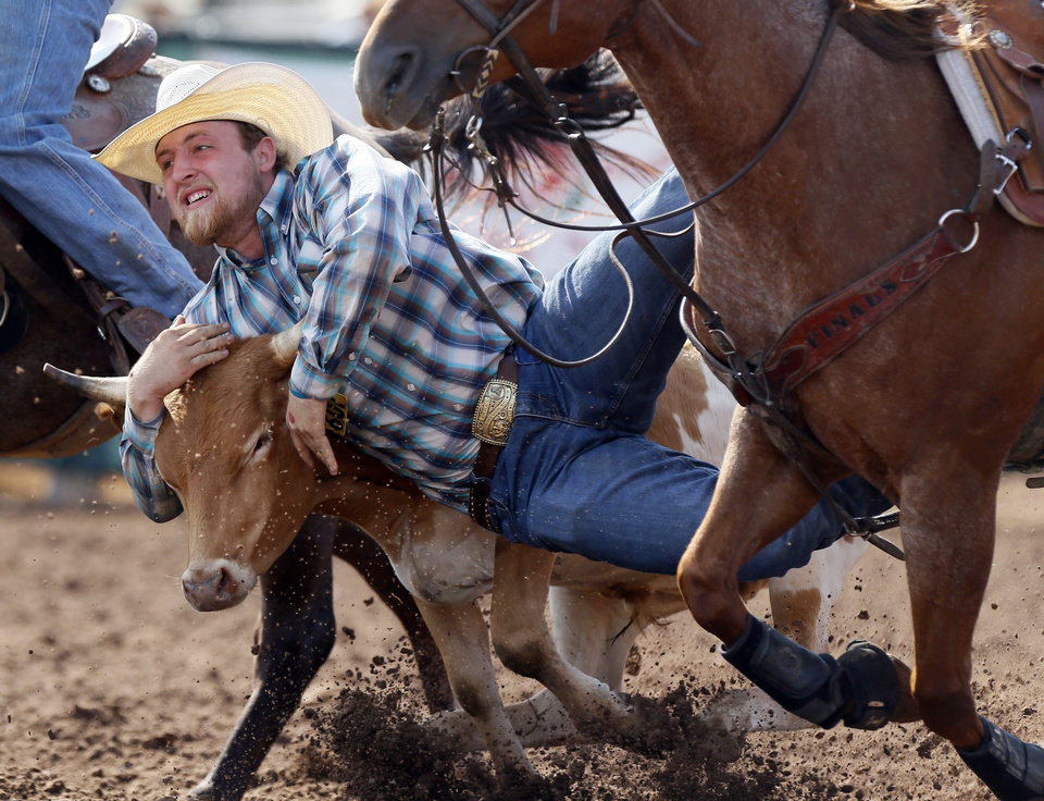 Photo - Trevor Mann of Humansville, Missouri, competes in steer wrestling during the International Finals Youth Rodeo at the Heart of Oklahoma Exposition Center in Shawnee, Okla., Thursday morning, July 11, 2019. [Nate Billings/The Oklahoman]