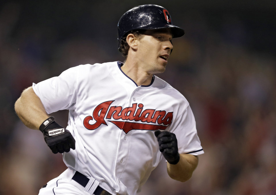 Cleveland Indians' Matt Carson runs out a bases-loaded single in the 11th inning that drove in the winning run in a 2-1 win over the Houston Astros in a baseball game Thursday, Sept. 19, 2013, in Cleveland. (AP Photo/Mark Duncan)