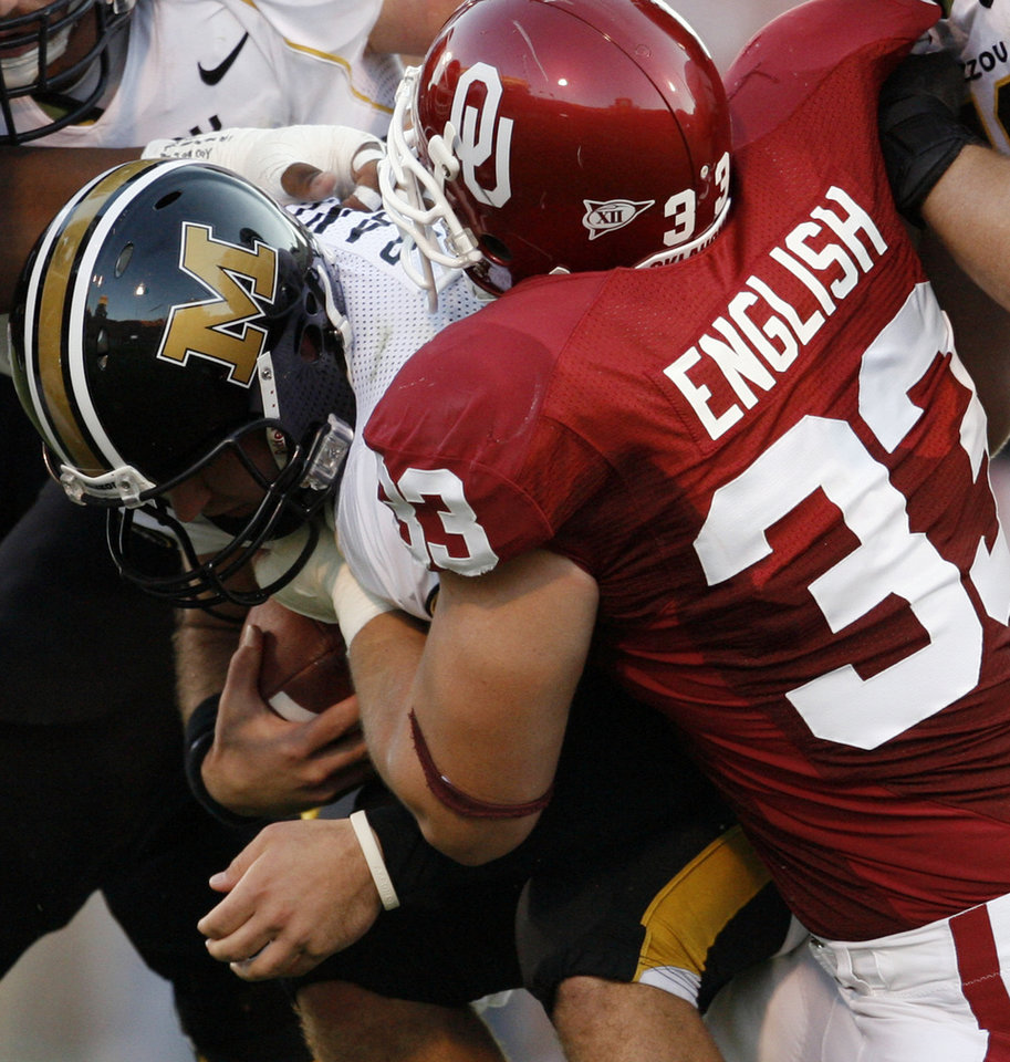 Photo - Oklahoma's Auston English (33) brings down Missouri quarterback Chase Daniel (10) for a sack during the first half of the college football game between the University of Oklahoma Sooners (OU) and the University of Missouri Tigers (MU) at the Gaylord Family Oklahoma Memorial Stadium on Saturday, Oct. 13, 2007, in Norman, Okla.By STEVE SISNEY, The Oklahoman