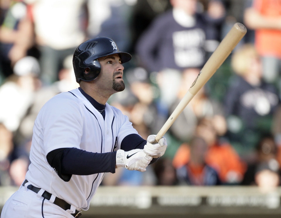 Photo -   Detroit Tigers' Alex Avila watches his two-run walk-off home in the 11th inning of a baseball game against the Boston Red Sox on Sunday, April 8, 2012, in Detroit. The Tigesr won 13-12(AP Photo/Duane Burleson)