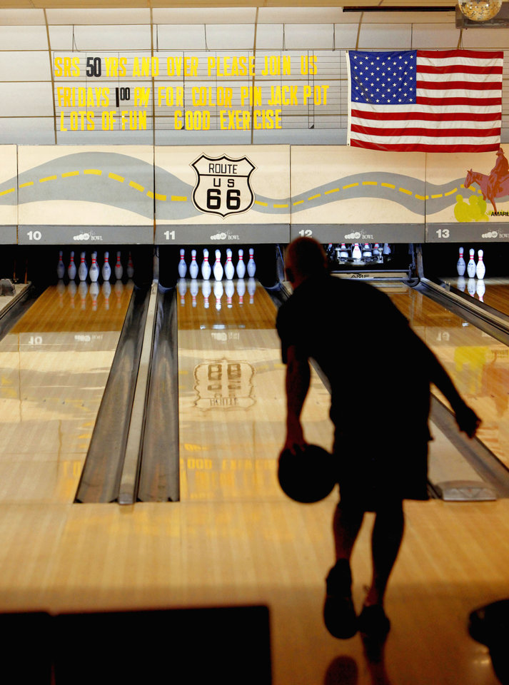 Photo - A bowler takes his turn at 66 Bowl in Oklahoma City on Wednesday. The bowling alley at NW 39 and Willow Springs Avenue turns 50 this year. Photo by bryan terry, the oklahoman