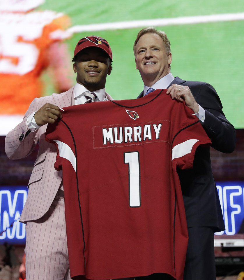 Photo - Oklahoma quarterback Kyler Murray poses with NFL Commissioner Roger Goodell after the Arizona Cardinals selected Murray in the first round at the NFL football draft, Thursday, April 25, 2019, in Nashville, Tenn. (AP Photo/Mark Humphrey)