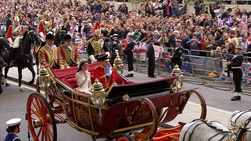 Photo - In this image taken from video, Britain's Prince William, right and his wife, Kate, the Dutchess of Cambridge, ride in an open carriage toward Buckingham Palace during the Royal Wedding in London on Friday, April, 29, 2011. (AP Photo/APTN) EDITORIAL USE ONLY NO ARCHIVE PHOTO TO BE USED SOLELY TO ILLUSTRATE NEWS REPORTING OR COMMENTARY ON THE FACTS OR EVENTS DEPICTED IN THIS IMAGE ORG XMIT: RWVM302