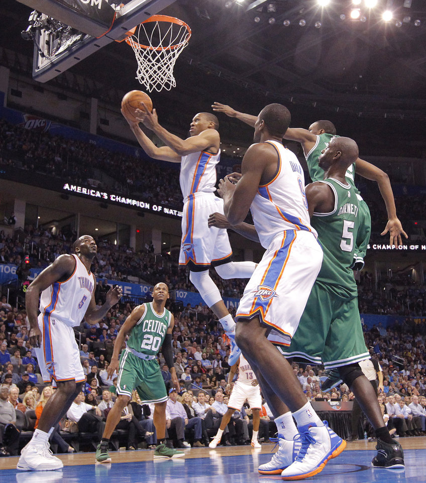 Oklahoma City Thunder point guard Russell Westbrook (0) drives to the basket past Boston Celtics power forward Kevin Garnett (5) during the NBA basketball game between the Oklahoma City Thunder and the Boston Celtics at the Chesapeake Energy Arena on Wednesday, Feb. 22, 2012 in Oklahoma City, Okla.  Photo by Chris Landsberger, The Oklahoman