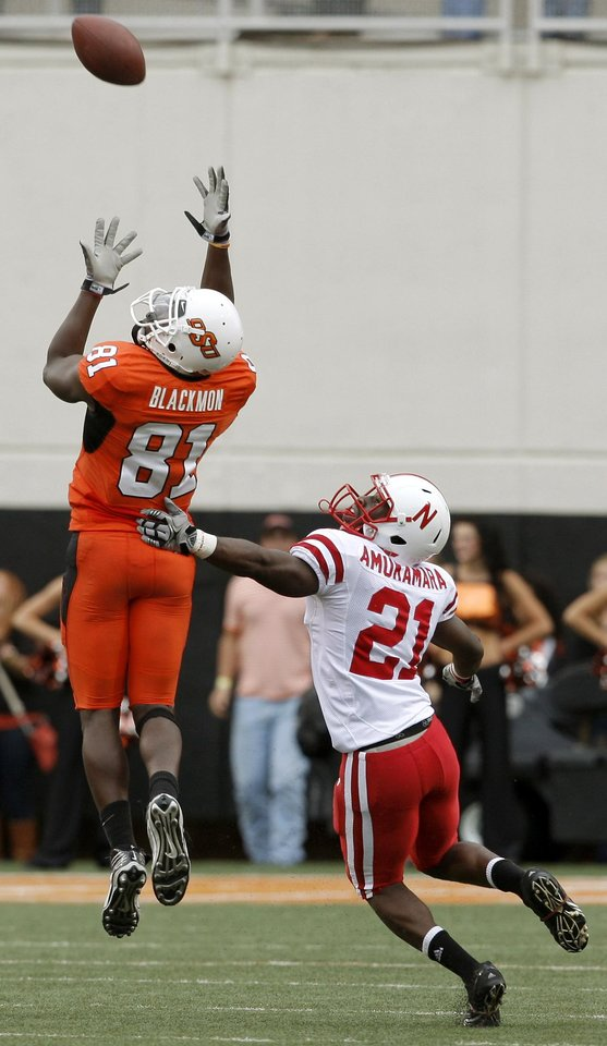 Photo - OSU's Justin Blackmon catches a touchdown pass over Nebraska's Prince Amukamara during the college football game between the Oklahoma State Cowboys (OSU) and the Nebraska Huskers (NU) at Boone Pickens Stadium in Stillwater, Okla., Saturday, Oct. 23, 2010. Photo by Bryan Terry, The Oklahoman