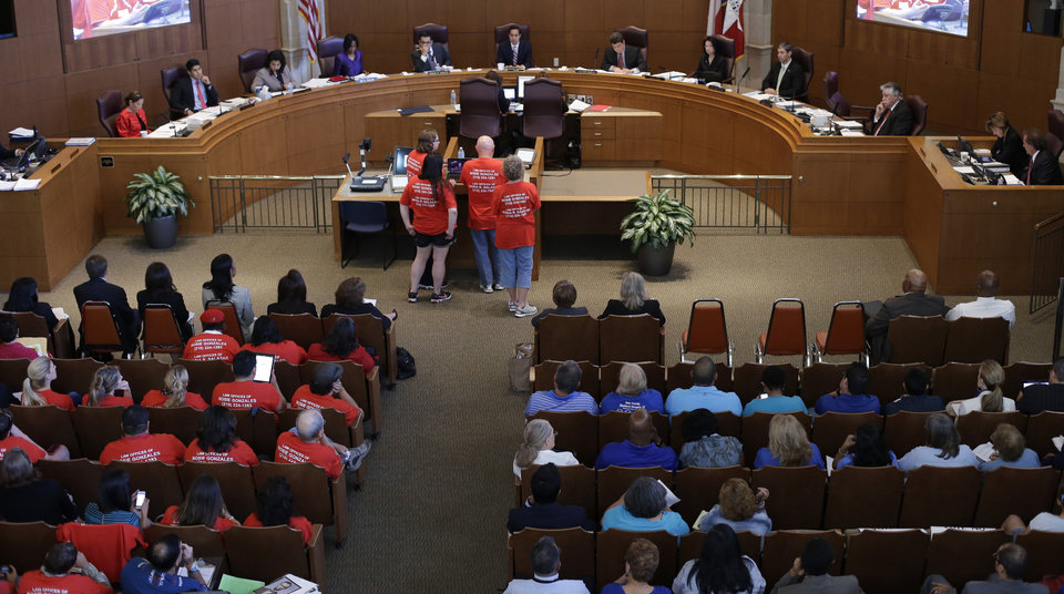 Photo - The San Antonio city council listens to testimony before voting on a non-discrimination ordinance, Thursday, Sept. 5, 2013, in San Antonio. The ordinance passed and in part will prohibit discrimination based on sexual orientation and gender identity.  (AP Photo/Eric Gay)