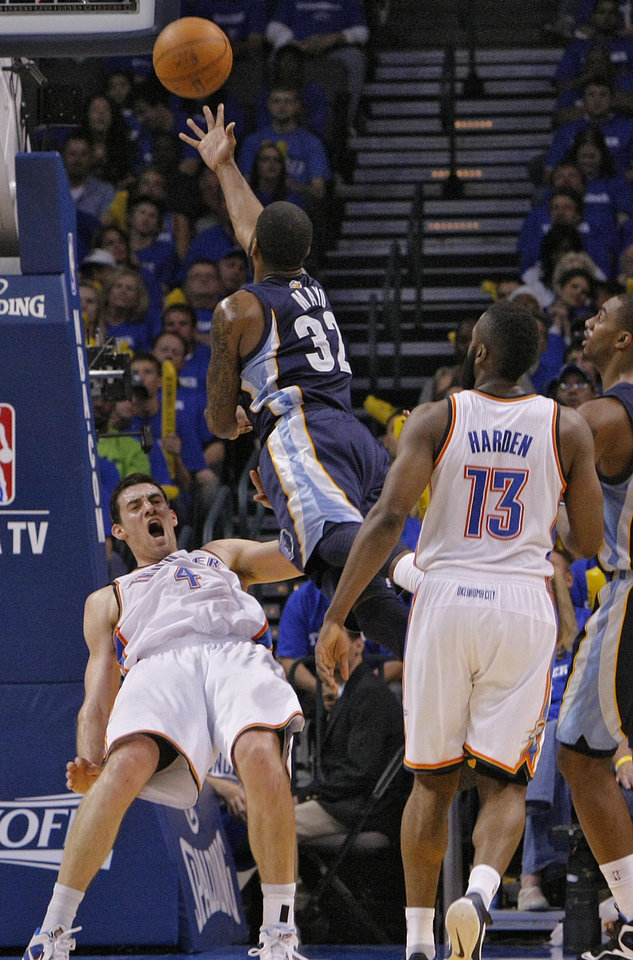 Oklahoma City\'s Nick Collison (4) is called for a blocking foul against O.J. Mayo (32) of Memphis during game two of the Western Conference semifinals between the Memphis Grizzlies and the Oklahoma City Thunder in the NBA basketball playoffs at Oklahoma City Arena in Oklahoma City, Tuesday, May 3, 2011. Photo by Chris Landsberger, The Oklahoman
