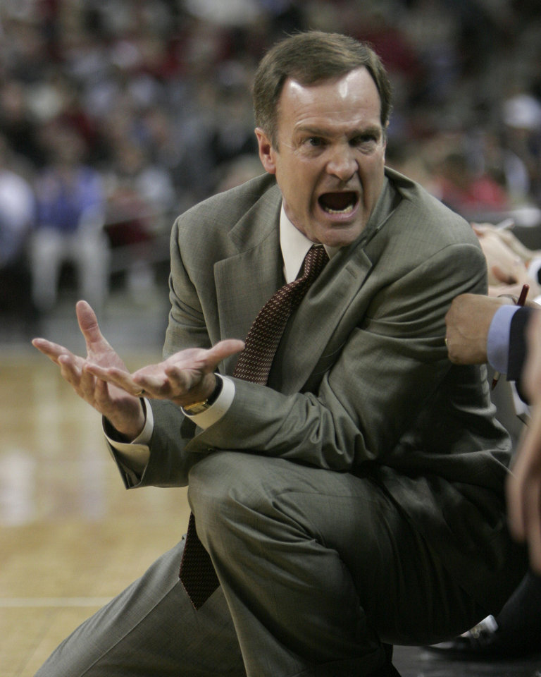 Photo - UNLV coach Lon Kruger talks to his bench during UNLV's NIT college basketball game against South Carolina Tuesday, March 22, 2005, in Columbia, S.C.  (AP Photo/Perry Baker)