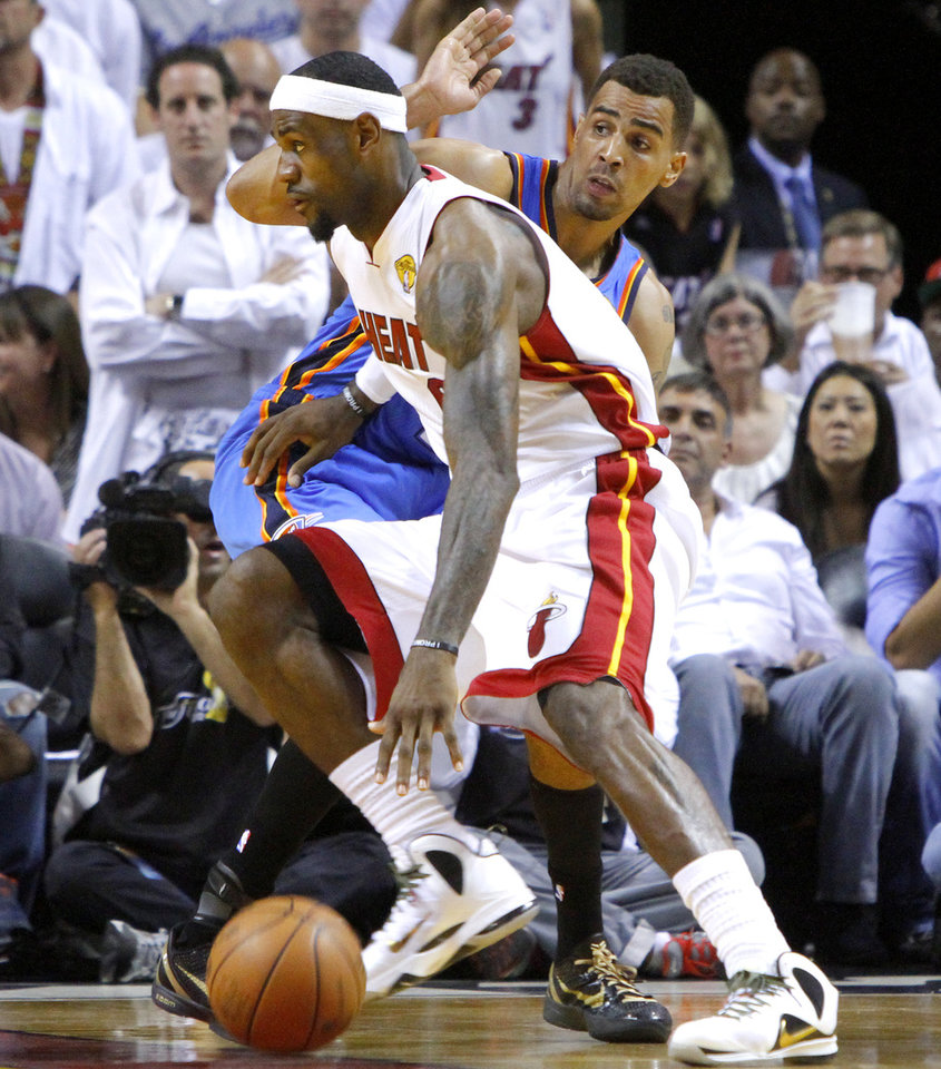 Miami\'s LeBron James (6) goes past Oklahoma City\'s Thabo Sefolosha (2) during Game 4 of the NBA Finals between the Oklahoma City Thunder and the Miami Heat at American Airlines Arena, Tuesday, June 19, 2012. Photo by Bryan Terry, The Oklahoman