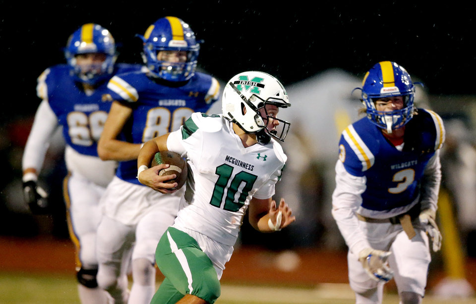 Photo - Bishop McGuinness's Luke Tarman rushes during the high school football game between Piedmont and Bishop McGuinness at Piedmont High School in Piedmont, Okla.,  Friday, Oct. 25, 2019. [Sarah Phipps/The Oklahoman]