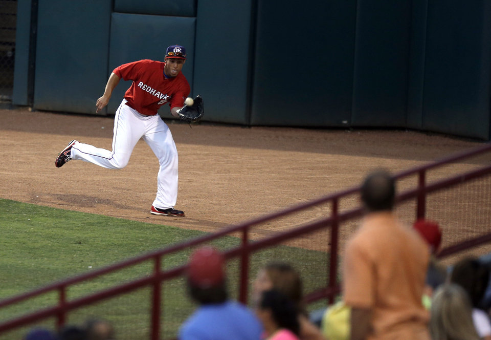 Photo - Oklahoma City's George Springer makes a catch during a minor league baseball game between the Oklahoma City RedHawks and the Albuquerque Isotopes at the Chickasaw Bricktown Ballpark in Oklahoma City. Photo by Sarah Phipps, The Oklahoman
