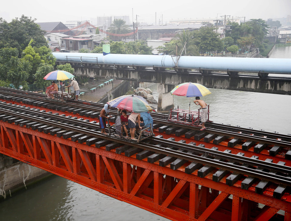 Photo - Commuters ride on a locally-built cart known as