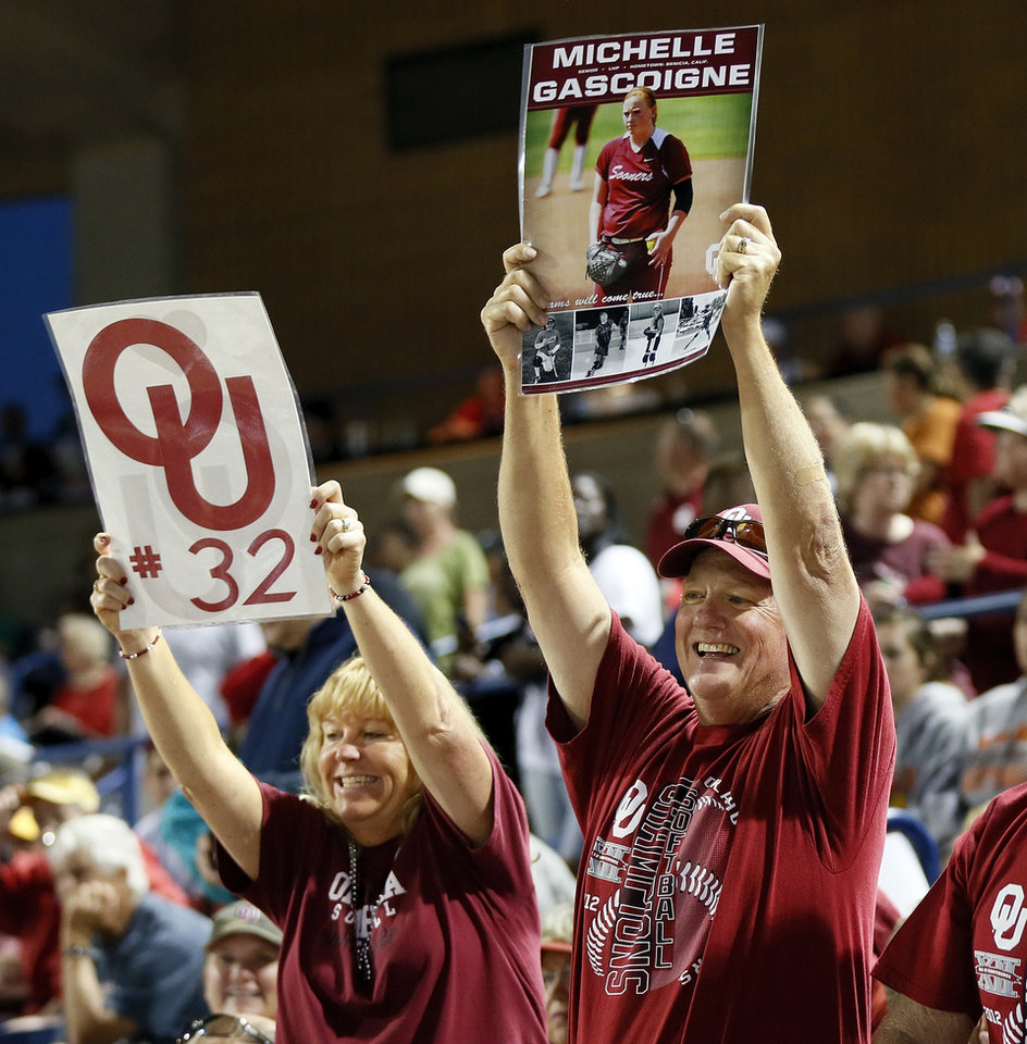 Photo - Lorri Gascoigne and Gary Gascoigne, parents of OU player Michelle Gascoigne, cheer before an NCAA softball game in the Women's College World Series between Oklahoma and Michigan at ASA Hall of Fame Stadium, Thursday, May 30, 2013. Photo by Nate Billings, The Oklahoman