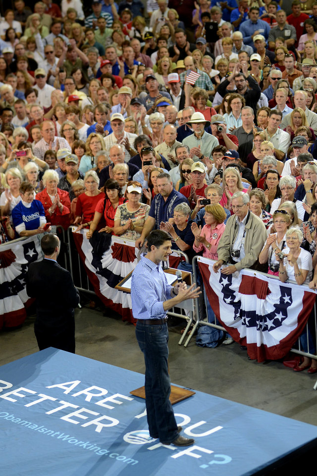 Photo -   Republican vice presidential candidate, Rep. Paul Ryan, R-Wis. speaks at WestPac Restorations in Colorado Springs, Colo., Thursday, Sept. 6, 2012. (AP Photo/Bryan Oller)
