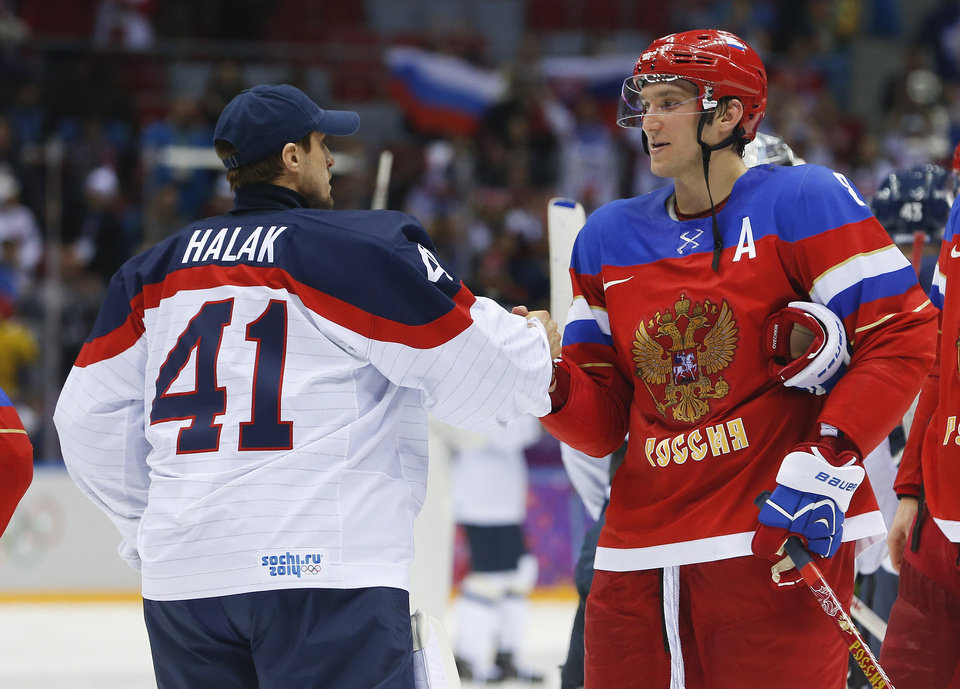 Photo - Russia forward Alexander Ovechkin, right, greets Slovakia goaltender Jaroslav Halak at the end of a shootout of a men's ice hockey game at the 2014 Winter Olympics, Sunday, Feb. 16, 2014, in Sochi, Russia. Russia won 1-0. (AP Photo/Mark Humphrey)
