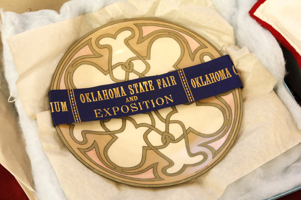 A ribbon from the Oklahoma State Fair Exposition and plate found in the Century Chest at First Lutheran Church in Oklahoma City Monday, April 22, 2013. The Century Chest is a time capsule put together and buried April 22, 1913 by the church. Photo by Paul B. Southerland, The Oklahoman