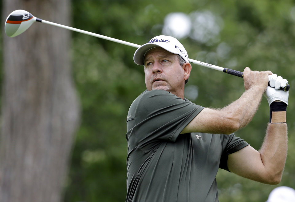 Photo - Bart Bryant watches his tee shot on the ninth hole during the second round of the Encompass Championship golf tournament in Glenview, Ill., Saturday, June 21, 2014. (AP Photo/Nam Y. Huh)
