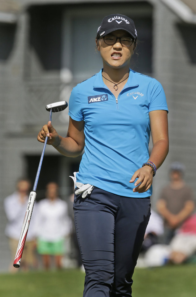 Photo - Lydia Ko, of New Zealand, grimaces as she missed a putt on the ninth green during the final round of the Kingsmill Championship golf tournament at the Kingsmill resort  in Williamsburg, Va., Sunday, May 18, 2014.   (AP Photo/Steve Helber)