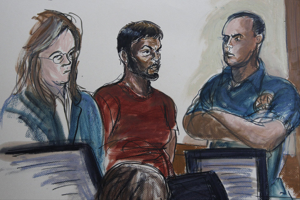 Photo -   This courtroom sketch shows Quazi Mohammad Rezwanul Ahsan Nafis, 21, center, and his attorney Heidi Cesare, left, in Brooklyn Federal Court Wednesday, Oct. 17, 2012, in New York. Quazi Mohammad Rezwanul Ahsan Nafis, 21, was arrested in a sting operation Wednesday morning after he parked a van filled with what he believed were explosives outside the building and tried to detonate it in a suicide mission, authorities said. (AP Photo/Elizabeth Williams)