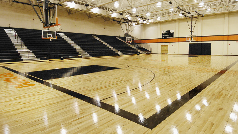 Photo - GYM, GYMNASIUM, RETRACTIBLE BLEACHERS: The  basketball court named for former coach Lawrence Cudjoe at Douglass High School under construction in Oklahoma City Thursday, Jan 12, 2006. The school is set to open next week. BY PAUL B. SOUTHERLAND, THE OKLAHOMAN