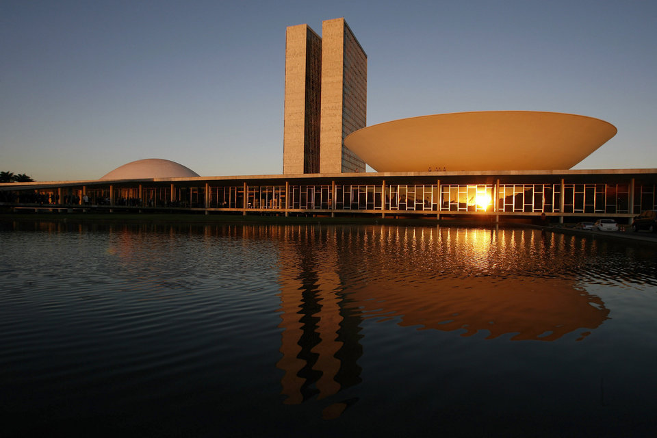 FILE - This Aug 14, 2007 file photo, shows a view of the Brazil's National Congress, designed by Brazilian architect Oscar Niemeyer and inaugurated in 1960, in Brasilia, Brazil. According to a hospital spokeswoman on Wednesday, Dec. 5, 2012, famed Brazilian architect Oscar Niemeyer has died at age 104.  (AP Photo/Eraldo Peres, File)
