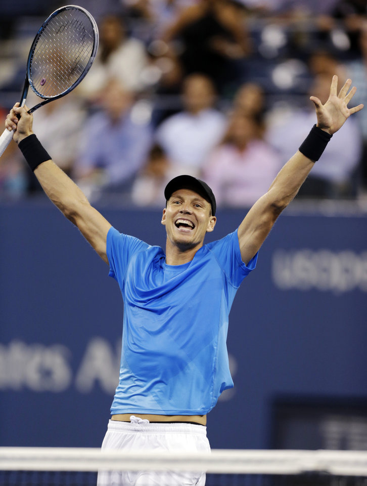 Photo -   Tomas Berdych, of the Czech Republic, raises his arms after defeating Roger Federer, of Switzerland, in the quarterfinal round of play at the U.S. Open tennis tournament, Wednesday, Sept. 5, 2012. in New York. Berdych won 7-6 (1), 6-4, 3-6, 6-3. (AP Photo/Charles Krupa)